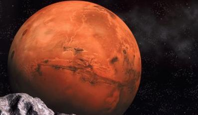 01 Jan 2000 --- NASA image of the planet Mars, featuring Valles Marineris, with a computer generated image of the surface of a moon in the foreground. --- Image by © Denis Scott/CORBIS