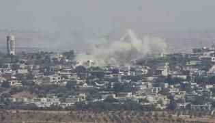 Dym nad miastem Jubata, widziany z terytorium Izraela